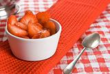 Fresh sliced strawberries in a white pot
