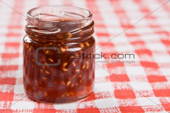 A small jar of raspberry jam