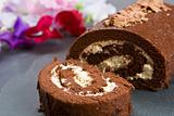 Homemade chocolate roll with fresh flowers