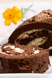 Sliced chocolate roll with a fresh flower