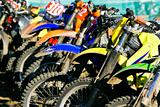 row of motobikes, close up at wheels