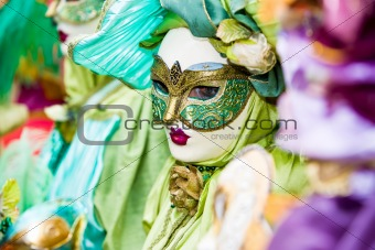Green and gold costume in Venice