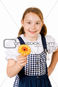 A pretty girl in a blue and white dress holding a yellow flower
