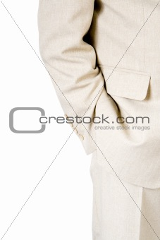 A business man with a hand in his pocket