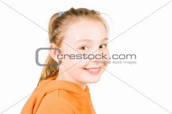 A smiling girl in an orange jumper