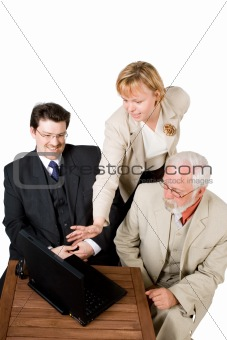 A business team looking at a laptop (4)