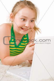 An attractive girl looking at a white laptop (2)