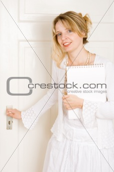 A woman opening a door