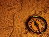 Compass and piece antique map and