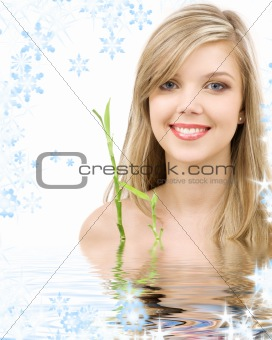 blue-eyed blonde with bamboo in water