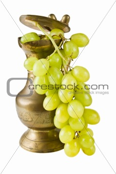 A copper pot with grapes