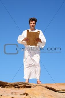 Man in robe reading
