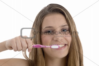 charming woman brushing her teeth