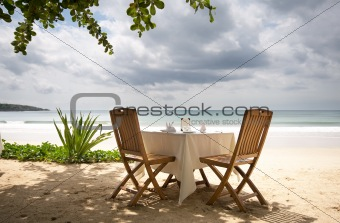 table and chairs on a beach