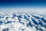 Over the clouds, high altitude