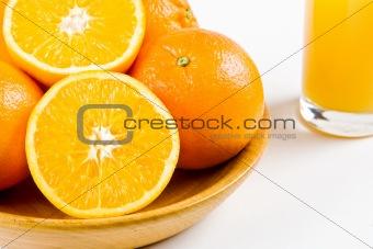 Oranges with a glass of orange juice
