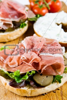 An open bagel sandwich