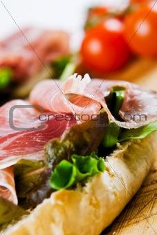 Close up of a parma ham sandwich