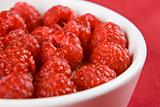 A dish of raspberries