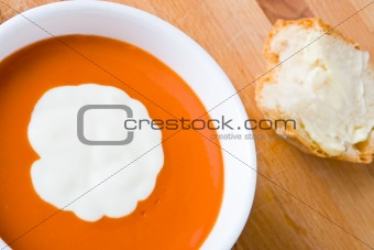 Tomato soup with cream and bread