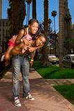 Black young urban couple making fun in street
