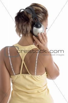 back pose of female with headphone