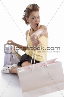 sitting sexy woman showing shopping bags
