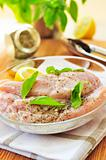 Raw chicken breasts marinating