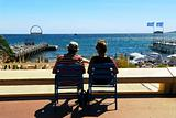 Couple relaxing in chairs in Cannes