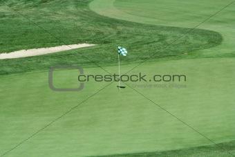 Green flag on a golf green