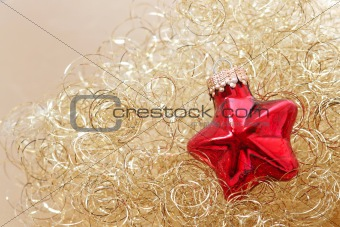 Red star christmas ornament in golden wool