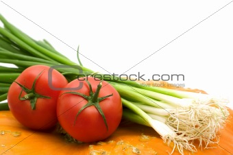 two tomatoes and vegetables