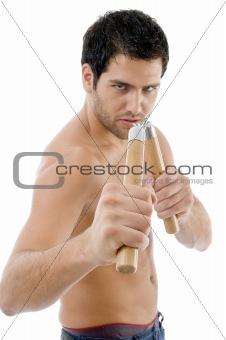 strong man holding nunchaku