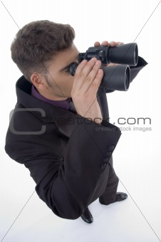 corporate man looking through binoculars