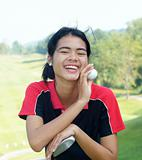 Female golf player laughing