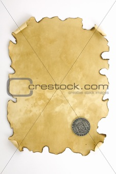 aged paper with old spanish coin
