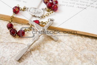 Rosary beads on a book of psalms
