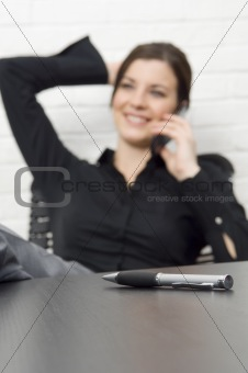 Attractive businesswoman on cell phone