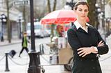 businesswoman in front of hot dog stand