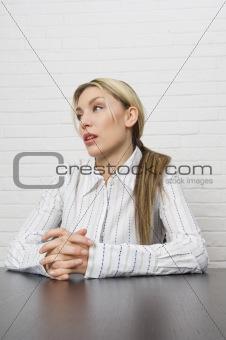 Attractive businesswoman at desk