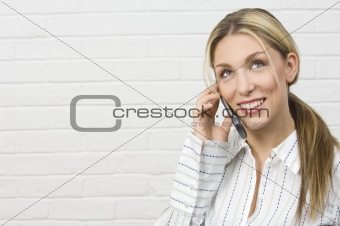 Attractive businesswoman thinking on mobile