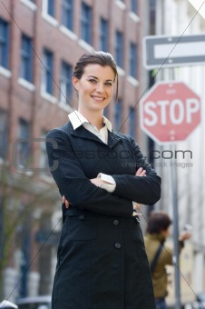 Business woman in front of stop sign