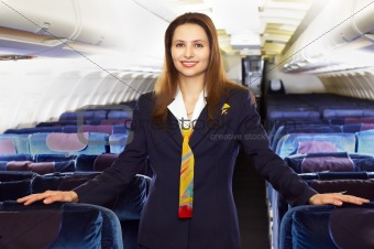 air hostess (stewardess) in the empty airliner cabin