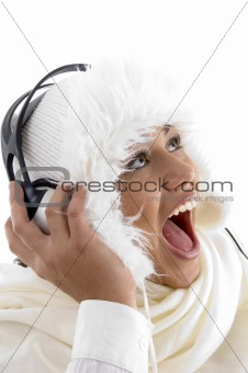 beautiful young girl enjoying music with headphones