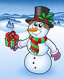 Christmas snowman in snowy landscape