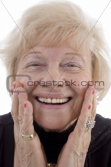 portrait of smiling old woman holding her face