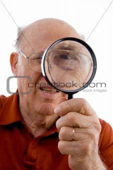 old man looking through lens