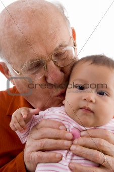 old man kissing the cute baby
