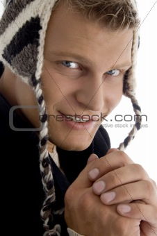 portrait of handsome model wearing woolen cap