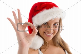 model with christmas hat and showing ok sign